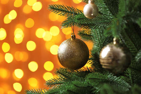 Photo pour Decorated Christmas tree against blurred lights on background. Bokeh effect - image libre de droit
