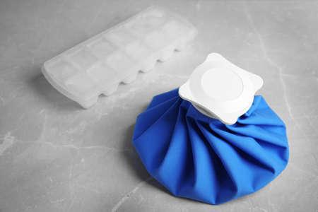 Foto für Composition with ice pack on marble table - Lizenzfreies Bild