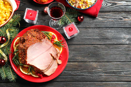 Photo pour Flat lay composition with delicious ham served on dark wooden table, space for text. Christmas dinner - image libre de droit