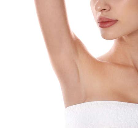 Photo pour Young woman showing armpit on white background, closeup. Epilation procedure - image libre de droit