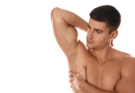 Photo pour Handsome man showing hairy armpit on white background. Epilation procedure - image libre de droit