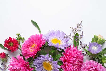 Foto de Composition with beautiful aster flowers on white background, top view - Imagen libre de derechos