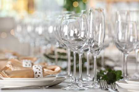 Photo for Table setting with empty glasses, plates and cutlery indoors - Royalty Free Image