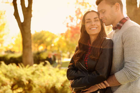 Photo for Happy couple in sunny park. Autumn walk - Royalty Free Image