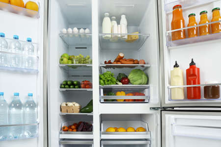 Photo for Open refrigerator full of different fresh products - Royalty Free Image