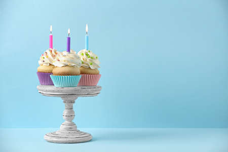 Photo pour Birthday cupcakes with candles on light blue background, Space for text - image libre de droit
