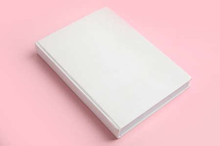 Photo for Book with blank cover on pink background - Royalty Free Image