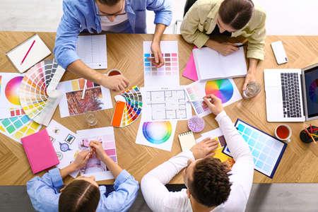 Photo pour Professional team of interior designers working at table, top view - image libre de droit