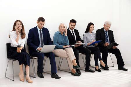 Photo pour People waiting for job interview in office - image libre de droit