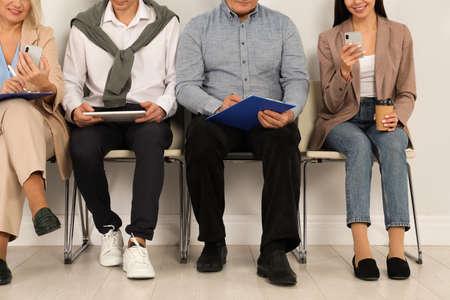 Photo pour People waiting for job interview in office, closeup - image libre de droit