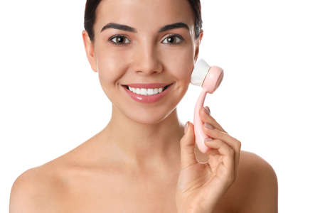 Photo for Young woman using facial cleansing brush on white background. Washing accessory - Royalty Free Image