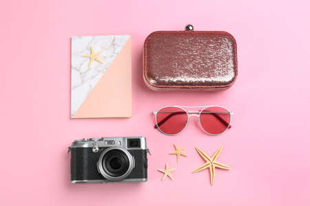 Photo for Flat lay composition with camera for professional photographer on pink background - Royalty Free Image