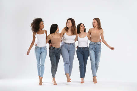 Photo pour Group of women with different body types on light background - image libre de droit