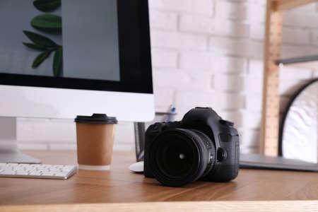 Foto de Photographer's workplace with professional camera in office - Imagen libre de derechos