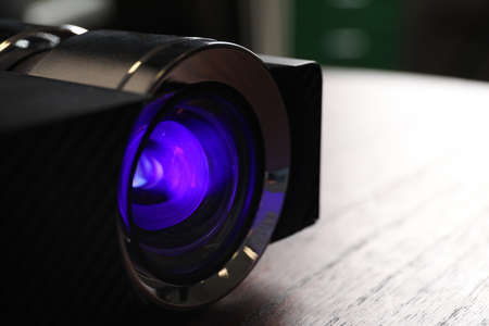 Closeup view of modern digital video projector on table