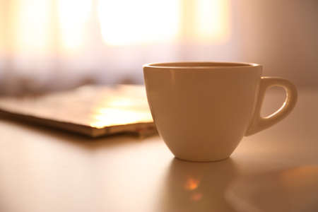Photo pour Cup of hot drink on table, space for text. Lazy morning - image libre de droit