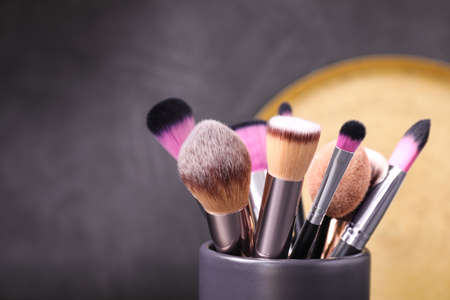 Photo for Set of professional makeup brushes in holder, closeup - Royalty Free Image