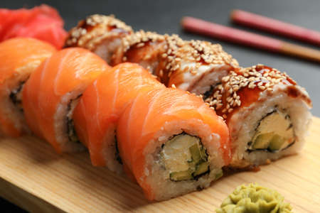 Photo for Delicious sushi rolls on wooden tray, closeup - Royalty Free Image