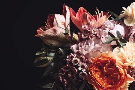 Foto de Beautiful bouquet of different flowers on black background. Floral card design with dark vintage effect - Imagen libre de derechos