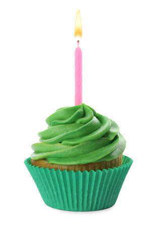 Photo pour Delicious birthday cupcake with candle and green cream isolated on white - image libre de droit