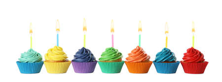 Photo pour Delicious birthday cupcakes with candles isolated on white - image libre de droit