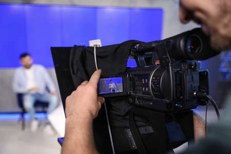 Photo pour Professional video camera operator working in studio, closeup - image libre de droit
