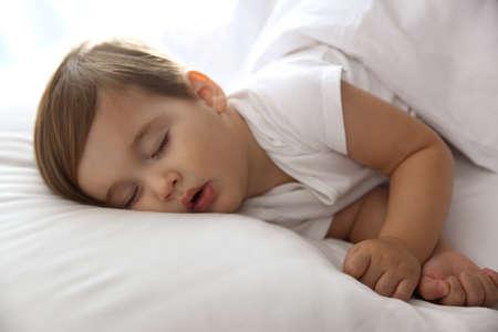 Photo pour Cute little baby peacefully sleeping at home. Bedtime - image libre de droit