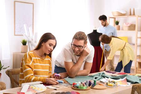 Photo pour Fashion designers creating new clothes in studio - image libre de droit