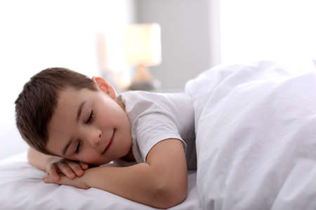 Photo for Cute little boy sleeping at home. Bedtime - Royalty Free Image