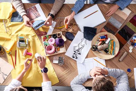 Photo pour Fashion designer creating new clothes in studio, top view - image libre de droit