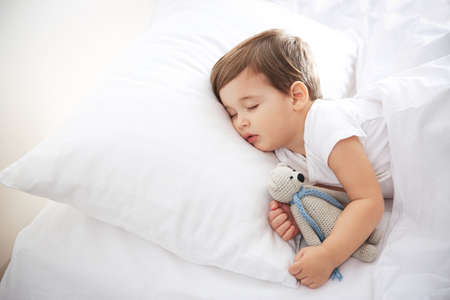Photo pour Cute little baby sleeping with toy at home. Bedtime - image libre de droit