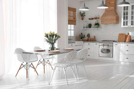 Foto de Beautiful kitchen interior with new stylish furniture - Imagen libre de derechos