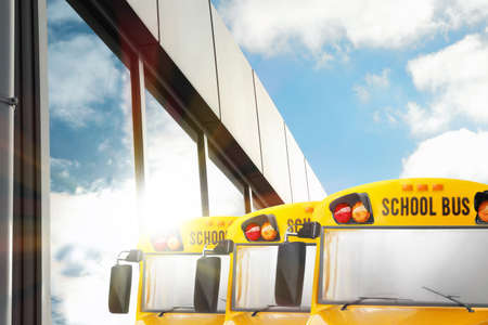 Photo pour Yellow school buses outdoors. Transport for students - image libre de droit