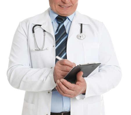 Photo pour Senior doctor with clipboard on white background, closeup - image libre de droit