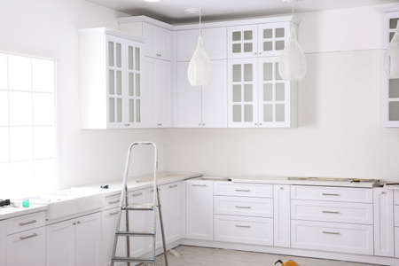 Photo for Renovated kitchen interior with stylish furniture and maintenance equipment - Royalty Free Image