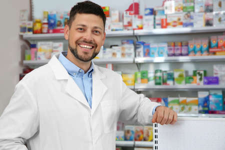 Photo for Portrait of professional pharmacist in modern drugstore - Royalty Free Image
