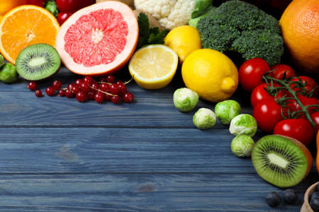 Photo for Fresh products rich in vitamin C on blue wooden table. Space for text - Royalty Free Image