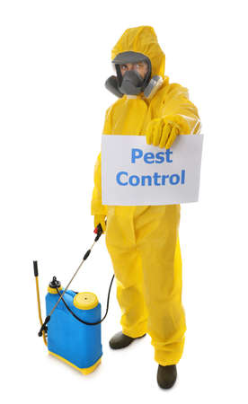 Photo pour Man wearing protective suit with insecticide sprayer and sign PEST CONTROL on white background - image libre de droit