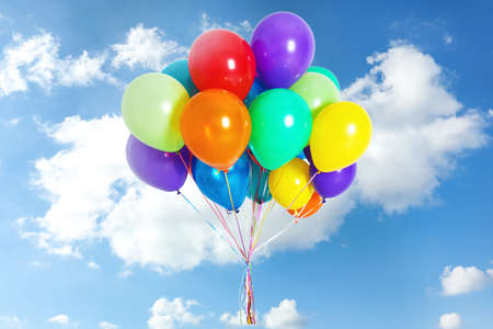 Photo for Many colorful balloons outdoors on sunny day - Royalty Free Image