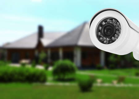 Photo for Home security system. House under CCTV camera surveillance - Royalty Free Image