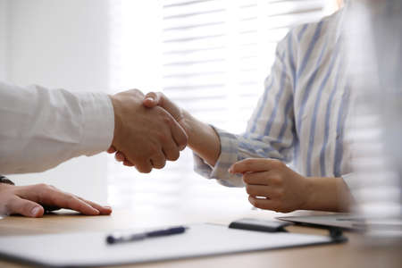 Photo for Business people shaking hands in office, closeup - Royalty Free Image