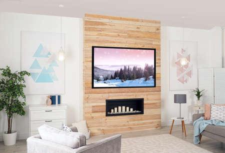 Foto de Living room interior with modern TV on wooden wall - Imagen libre de derechos