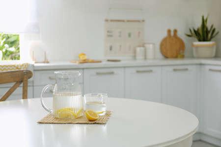Photo for Lemonade on white table in modern kitchen. Interior design - Royalty Free Image