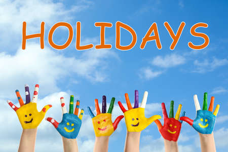 Photo pour School holidays. Children with painted palms and blue beautiful sky on background, closeup - image libre de droit