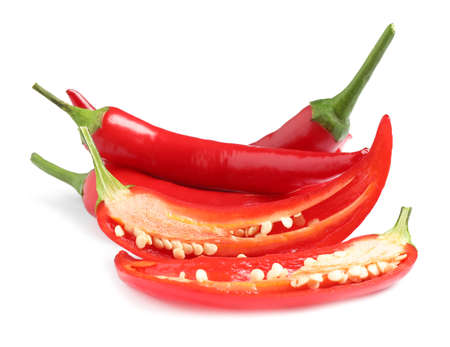 Foto für Cut and whole red hot chili peppers on white background - Lizenzfreies Bild