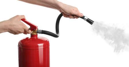 Photo pour Woman using fire extinguisher on white background, closeup - image libre de droit
