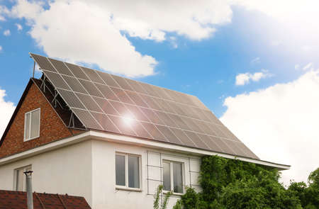 Photo for Building with installed solar panels on roof. Alternative energy source - Royalty Free Image