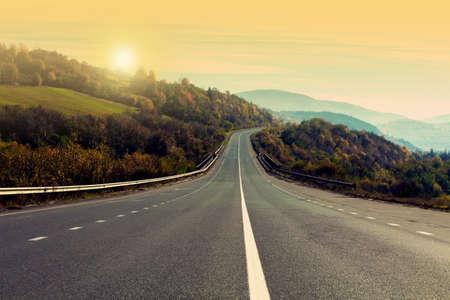 Photo pour Road trip. Beautiful view of asphalt highway at sunset - image libre de droit