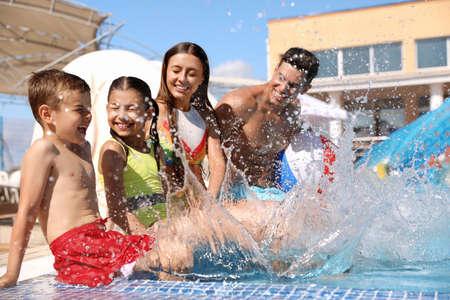 Photo for Happy family having fun at water park. Summer vacation - Royalty Free Image
