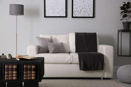 Foto de Modern comfortable sofa in stylish living room interior - Imagen libre de derechos